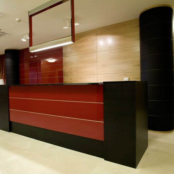 Bespoke Reception Counter - Dark Wood Red Panel