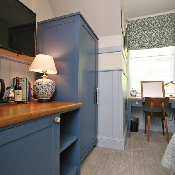 Bespoke Boutique Hotel Casegoods in Blue and Pine