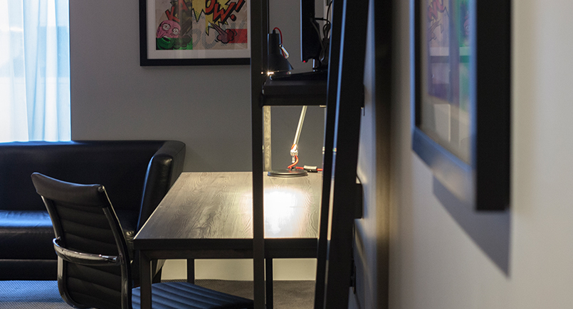Minimal dark rustic desk design with wall mounted tv