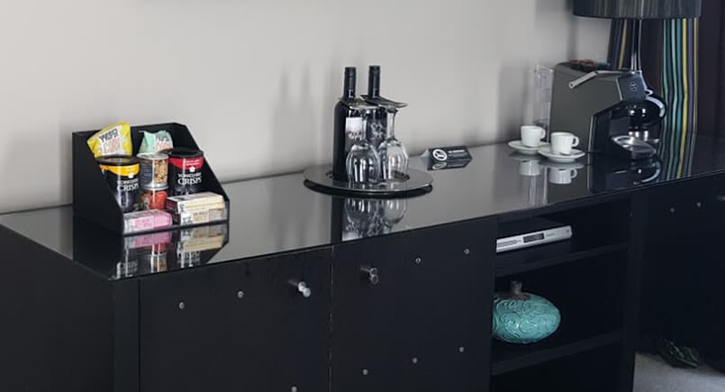 Black and glass hotel desk with tea and coffee on show