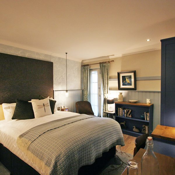 Blue Boutique Hotel Casegoods with high Headboard