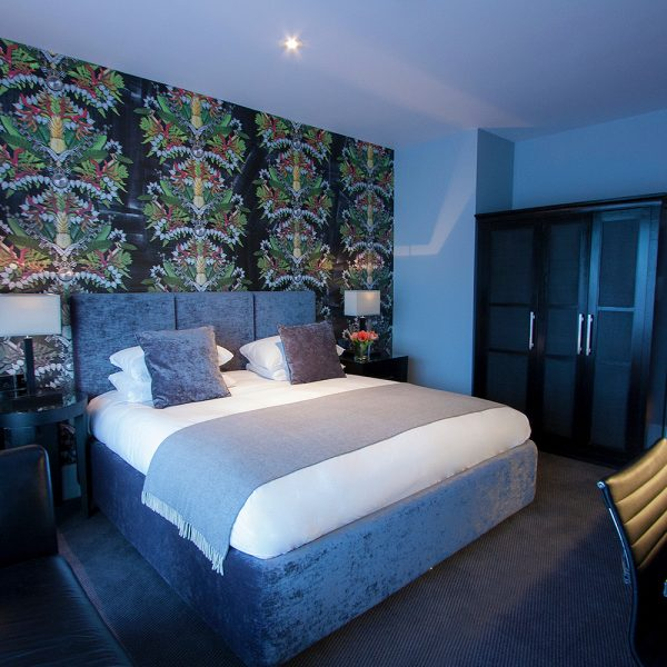 Dark Hotel Bedroom with Feature Wall Covering