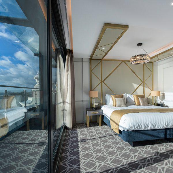 Floor to Ceiling Bespoke Headboard Design in Gold and Beige