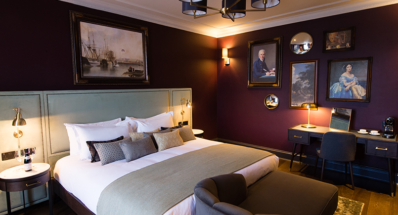 Teal velvet headboard with studding at Avon Gorge Hotel