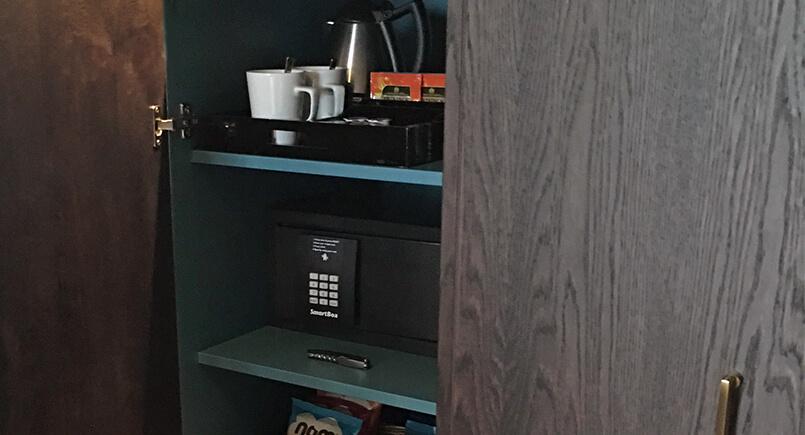 hotel bedroom in wardrobe tea and coffee making shelves
