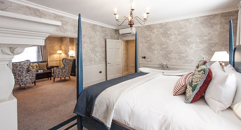 Blue Wooden Four Poster Hotel Bed