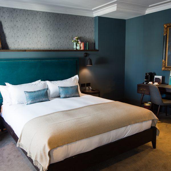 dark bespoke bedroom furniture with brass features
