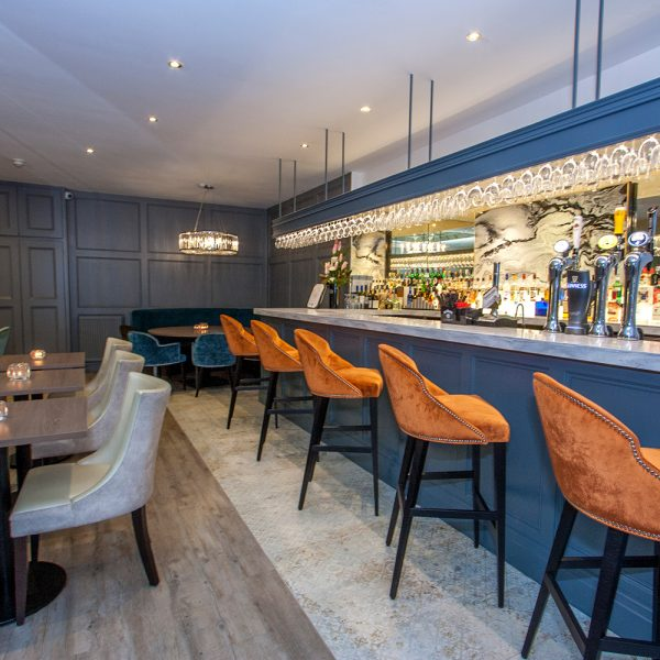 bar design with fielded panels and marble top
