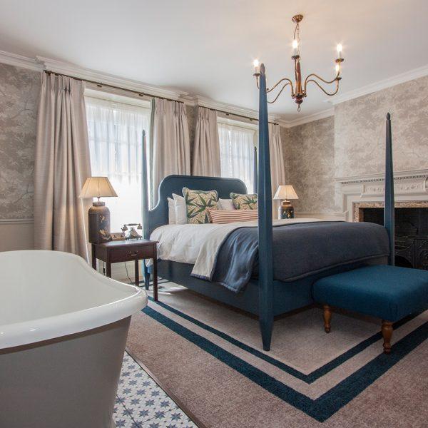 bespoke bedroom design of hotel blue four poster bed