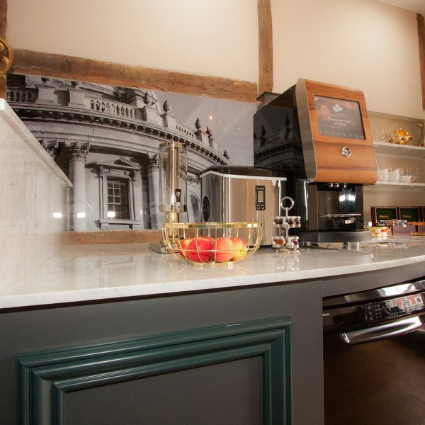 bespoke cupboards in black and white coffee station with fielded panels and marble top