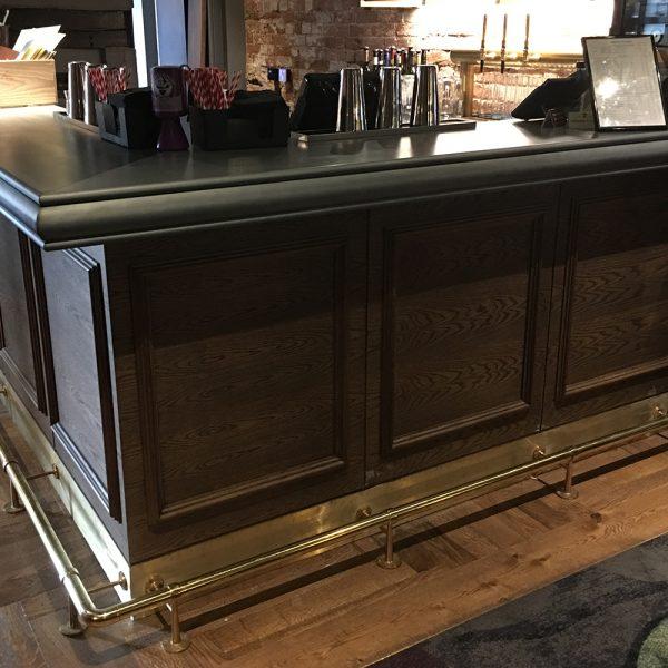 dark bespoke bar design with fielded panel detail