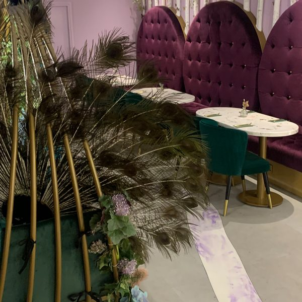 round bespoke banquette seating in purple with deep buttoning